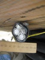 Фото сечения кабеля АВБбШв 3х120+1х70 с четырьмя алюминиевыми жилами в ПВХ изоляции, с бронёй в виде лент и в ПВХ шланге