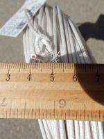 Фотография сечения термостойкого провода РКГМ 0,75 с многопроволочной жилой в кремнийорганической изоляции и оплётке из стекловолокна