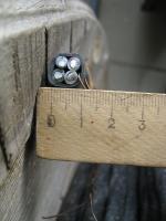 Фотография силового негорючего алюминиевого кабеля АВВГнг 3х6+1х4 для стационарной групповой прокладки